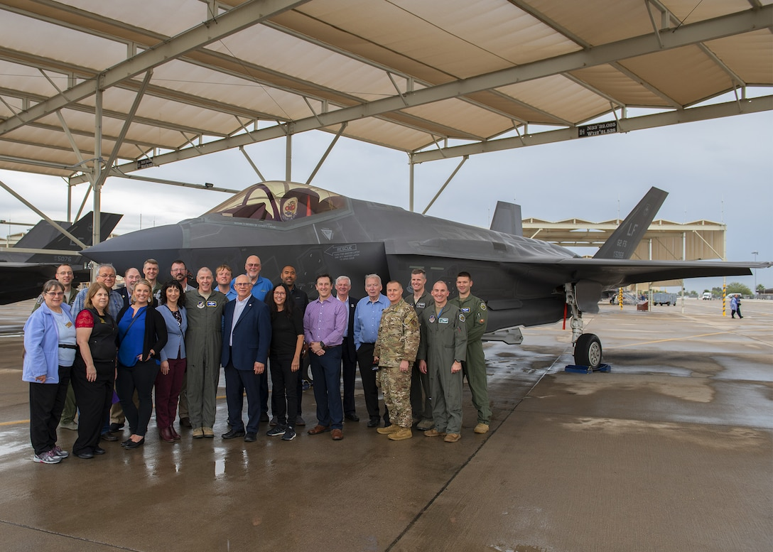 Eielson Air Force Base military and civic leaders pose by an F-35A Lightning II, Nov. 19, 2019, at Luke AFB, Ariz.