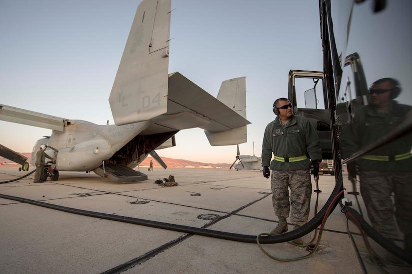 Man refuels aircraft.