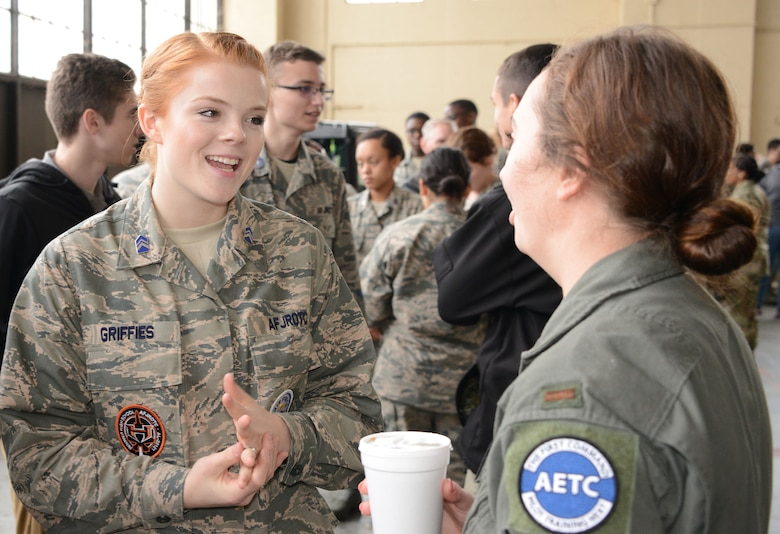 An Air Force mentor talks to a student during the Aim High Outreach event at Maxwell Air Force Base, Alabama.