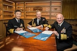 ANNAPOLIS, Md. (Nov. 20, 2019) Chief of Maritime Staff Adm. Hiroshi Yamamura, left, First Sea Lord Adm. Tony Radakin, and Chief of Naval Operations (CNO) Adm. Mike Gilday sign a Trilateral Head of Navy Joint Statement aboard the Royal Navy aircraft carrier HMS Queen Elizabeth (R08). The trilateral cooperation agreement reaffirms the three countries' commitment to increased collaboration and cooperation.