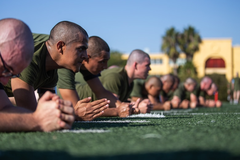 Recruits hold the plank position.