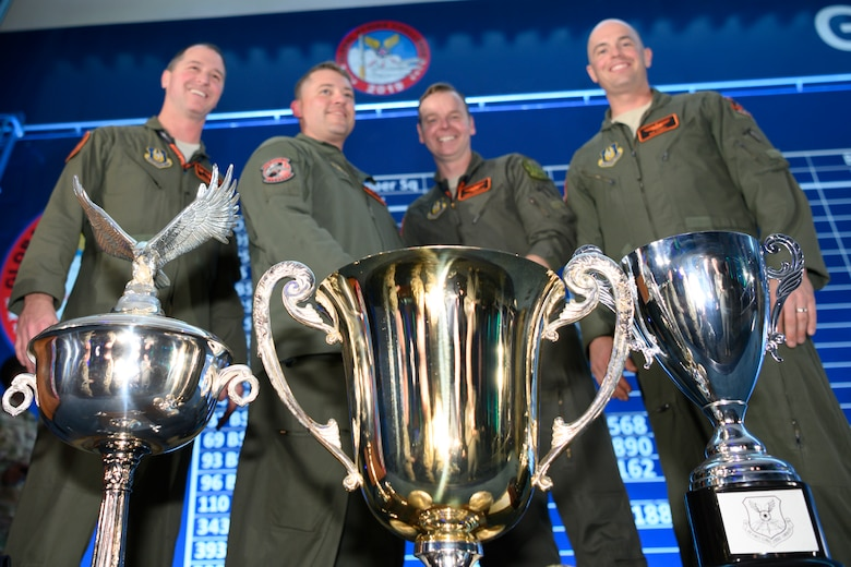 Photo of 343rd Bomb Squadron posing with trophies.