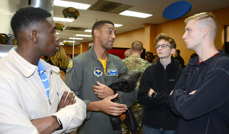 An Air Force mentor talks to students during the Aim High Outreach event at Maxwell Air Force Base, Alabama. Aim High is an Air Force Recruiting Service Detachment 1 sponsored event.