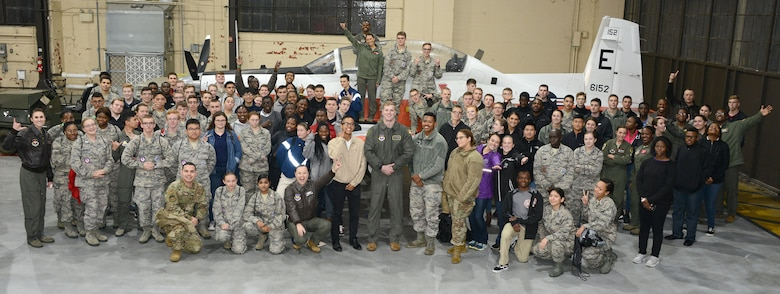 A group of students and their Air Force mentors take a group shot at an Aim High outreach event at Maxwell Air Force Base, Alabama.