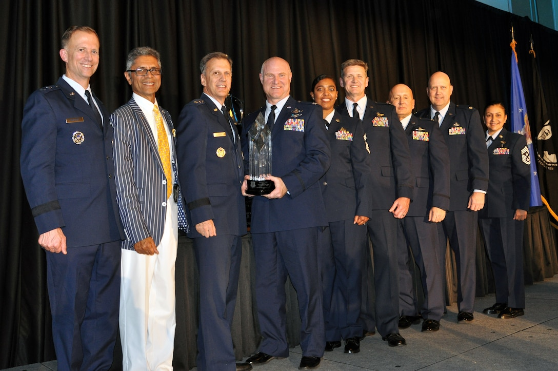"""Members from the 507th Air Refueling Wing, Tinker Air Force Base, Okla., accept the 2019 Raincross Trophy, and the title of """"Best of the Best in Fourth Air Force,"""" during the 20th Annual Raincross Awards dinner Nov. 19, 2019 at the Riverside Convention Center, Riverside, California. (U.S. Air Force photo by Candy Knight)"""