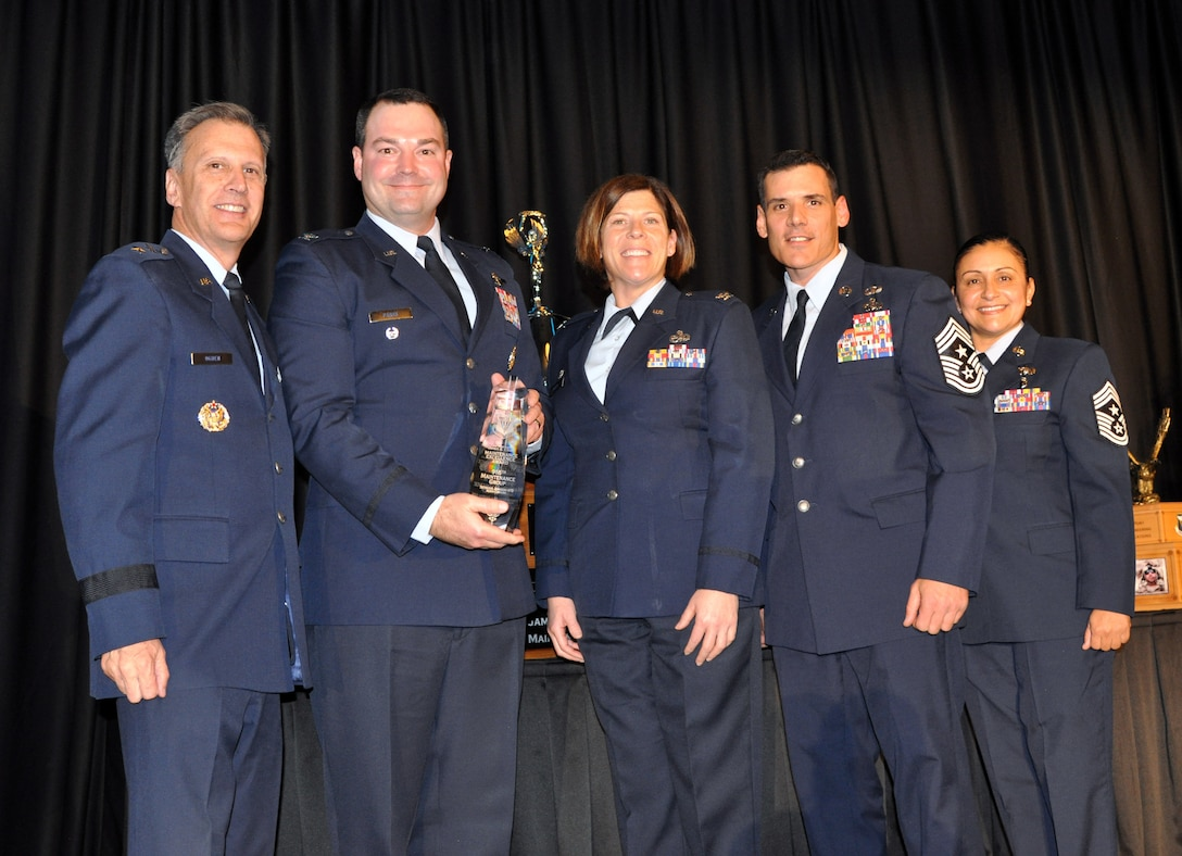 The 916th Maintenance Group is presented the Chief Master Sergeant James K. Clouse Trophy for Maintenance Excellence during the 20th Annual Raincross Awards dinner Nov. 19, 2019 at the Riverside Convention Center, Riverside, California. (U.S. Air Force photo by Candy Knight)