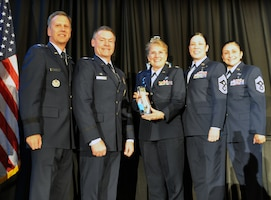 Members from the 439th Airlift Wing, Westover Air Reserve Station, Massachusetts, accept the 2019 Technical Sergeant Anthony C. Campbell, Jr. Trophy for Mission Support Group Excellence on behalf of the 439th Mission Support Group. The 439th MSG was honored for their continued ability to excel above and beyond the call on multiple occasions. This included executing 20 US Secret Service support missions, providing more than 2,000 personnel hours in support of President and Vice President of the United States. In addition, members of the group's Explosive Ordnance Disposal unit provided more than 130 hours as volunteer firefighters, responding to multiple emergency calls and saving multiple lives. (U.S. Air Force photo by Candy Knight)