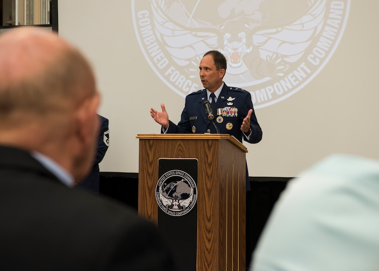 Maj. Gen. John E. Shaw, Combined Force Space Component Command and 14th Air Force commander, speaks during the CFSCC and 14th AF change of commander ceremony Nov. 20, 2019, at Vandenberg Air Force Base, Calif. As the new commander of the CFSCC, Shaw oversees the planning and execution of space operations through four distinct and geographically dispersed operations centers, including: Combined Space Operations Center at Vandenberg AFB, Calif; Missile Warning Center at Cheyenne Mountain Air Force Station, Colo; Joint Overhead Persistent Infrared Planning Center at Buckley AFB, Colo; and Joint Navigation Warfare Center located at Kirtland AFB, N.M. (U.S. Air Force photo by Airman 1st Class Aubree Milks)