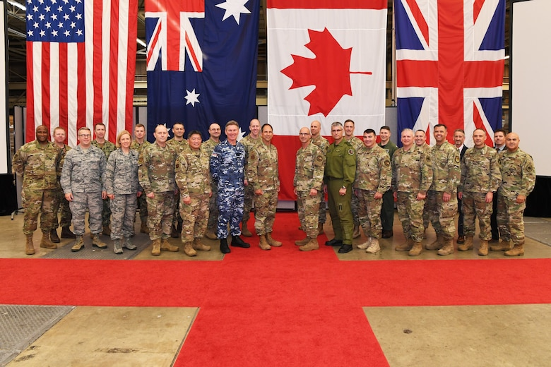 Senior space officials from Australia, Canada, the United Kingdom, and the United States pose for a photo during a Commander's Conference Nov. 20, 2019, at Vandenberg AFB, Calif. U.S. Air Force Maj. Gen. John E. Shaw, Commander, Combined Force Space Component Command and 14th Air Force, hosted the conference immediately following the CFSCC and 14th AF change of command ceremony. During the conference the commanders discussed their respective missions, as well as recent successes and challenges. (U.S. Air Force photo by Major Cody Chiles)