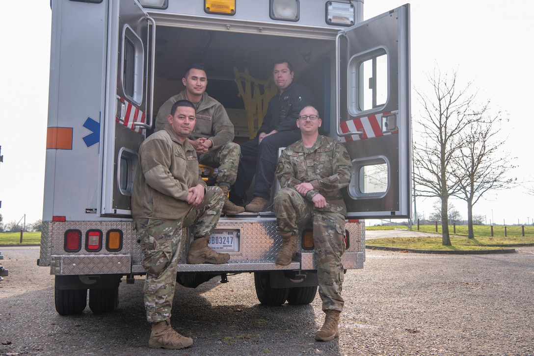 Medical personnel from the Aerospace Medicine Clinic pose for a photo on an ambulance Nov. 19, 2019, at RAF Mildenhall, England. The clinic ensures flyers are medically cleared to perform their duties while in the air. (U.S. Air Force photo by Airman 1st Class Joseph Barron)