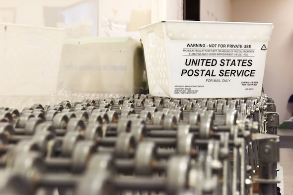 A United States Postal Service mail bin rests on a transfer table at the 39th Force Support Squadron Post Office, Nov. 20, 2019, at Incirlik Air Base, Turkey. Postal service Airmen encourage customers to check the suggested shipping dates to ensure packages reach their loved ones in time for the holidays. (U.S. Air Force photo by Staff Sgt. Eric Mann)