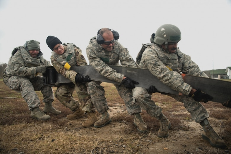 U.S. Air Force Airmen assigned to the 203rd RED HORSE Squadron, Virginia Air National Guard, set up a mobile aircraft arresting cable during a four-day field training exercise on Nov. 16, 2019. More than 150 Airmen participated in the exercise to practice skills they would perform in a deployed environment. (U.S. Air National Guard photo by Senior Airman Bryan Myhr)