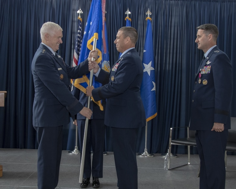 U.S. Air Force Lt. Gen. L. Scott Rice, Director, Air National Guard presents the unit flag to U.S. Air Force Brig. Gen. Frank M. Stokes as he assumes command of the Air National Guard Readiness Center (ANGRC) during a change of command ceremony Nov. 15, 2019, at Joint Base Andrews, Md. The change of command ceremony is military tradition that represents a formal transfer of authority and responsibility from one flag officer to another. (U.S. Air National Guard photo by Master Sgt. David J. Fenner)