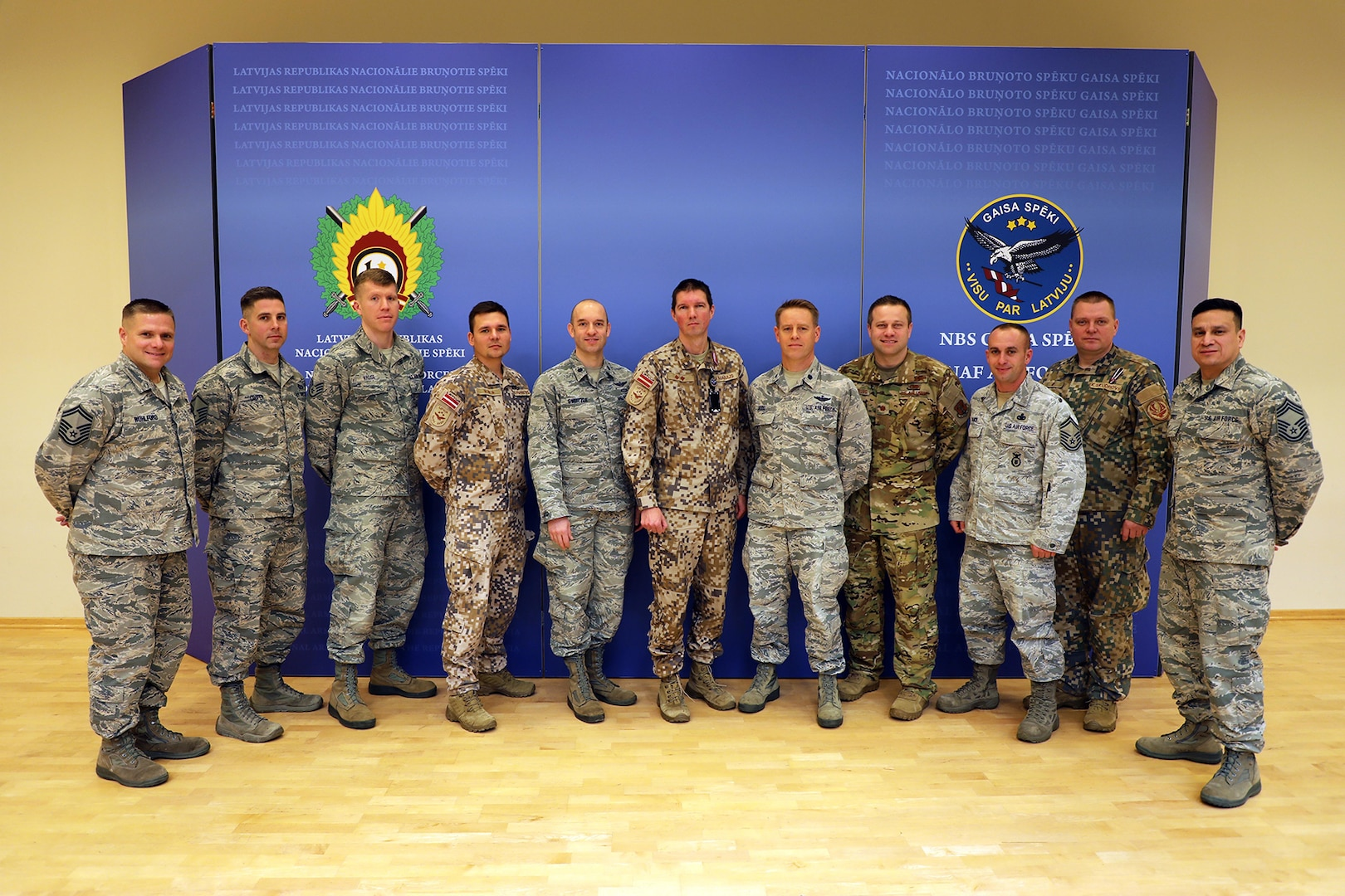 Members of the Michigan Air National Guard and the Latvian Air Force pose Nov. 15, 2019, after a planning meeting at Lielvārde Air Base, Latvia, to chart cooperation under the National Guard Bureau's State Partnership Program.