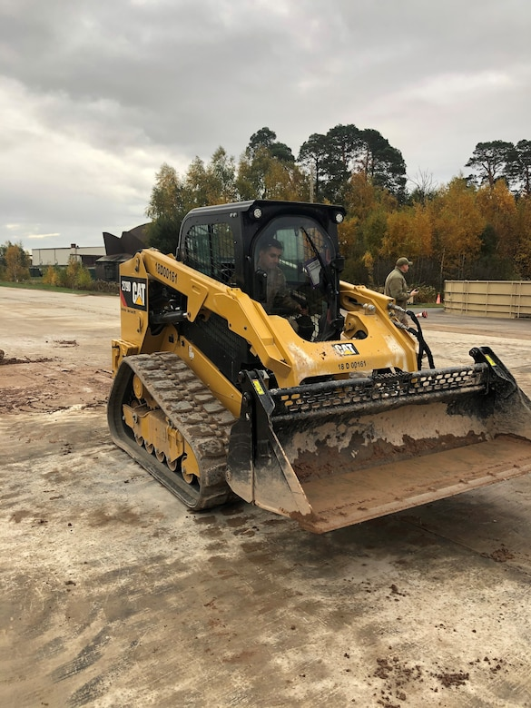 A Contingency Response Group Airman focuses while operating a compact track loader during Hybrid Airman training at Ramstein Air Base, Germany, Nov. 7, 2019. A CTL is a versatile piece of machinery that can be equipped with various tools depending on the situation. (U.S. Air Force photo by Capt. Daniel McKeown)