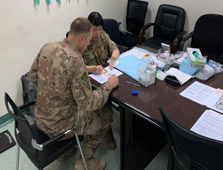 Maj. Montes De Oca provides one-on-one nutrition counseling