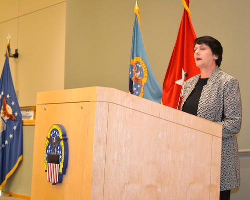 Pam Latker, Defense Logistics Agency Training Career Management Division chief, addresses the latest group of students to graduate the DLA Pathways to Career Excellence Program during a ceremony at the DLA Troop Support headquarters in Philadelphia on Nov. 19, 2019. There were 139 graduates from the two-year program.