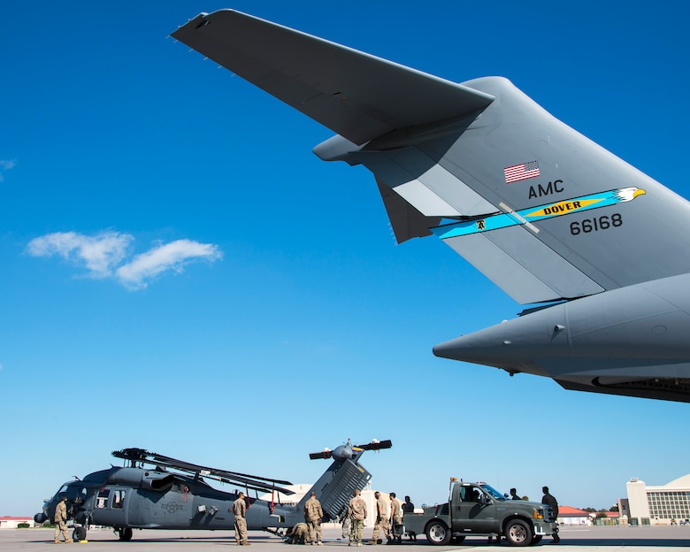 U.S. Air Force Airmen upload an HH-60 Pave Hawk helicopter assigned to the 305th Rescue Squadron (RQS), Davis-Monthan Air Force Base, Ariz., onto a C-17 Globemaster III assigned to the 436th Airlift Wing (AW), Dover Air Force Base, Dela., at MacDill Air Force Base, Fla., Nov. 20, 2019.