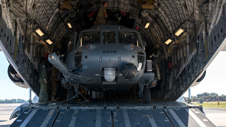 An HH-60 Pave Hawk helicopter assigned to the 305th Rescue Squadron (RQS), Davis-Monthan Air Force Base, Ariz., sits inside a C-17 Globemaster III assigned to the 436th Airlift Wing, Dover Air Force Base, Dela., at MacDill Air Force Base, Fla., Nov. 20, 2019.