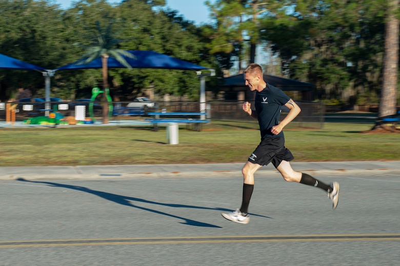 A photo of a participant running toward the finish line during the Gobble 'Til You Wobble 5K
