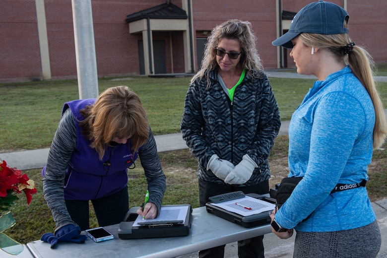 A photo of participants signing in to the Gobble 'Til You Wobble 5K