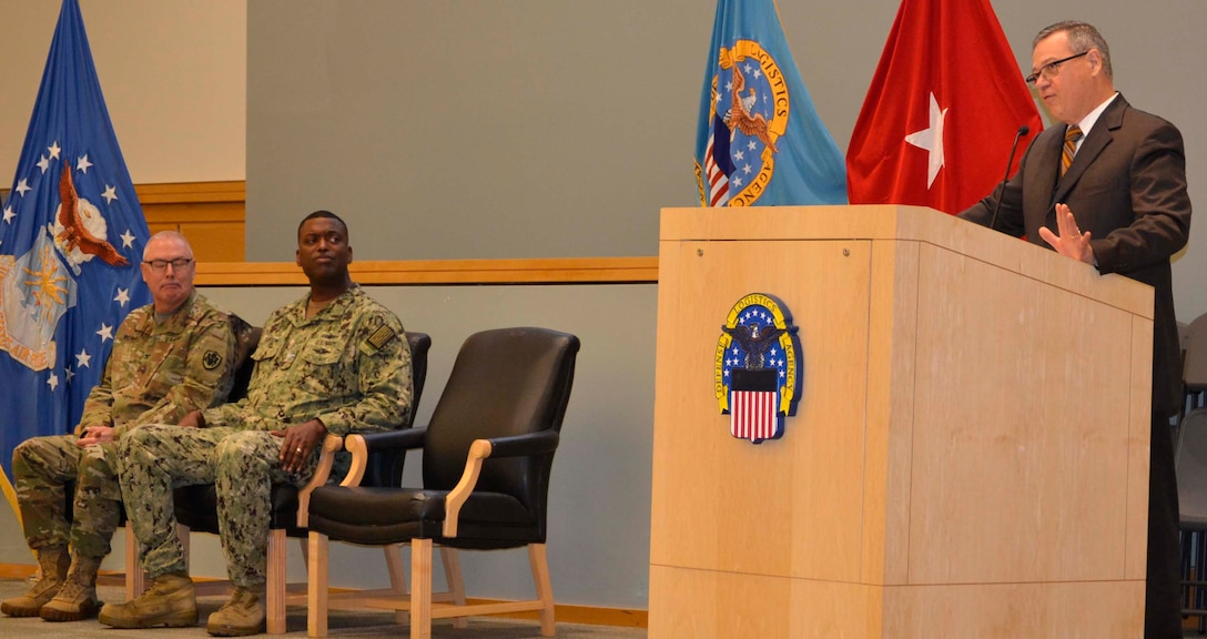 DLA Troop Support Deputy Commander Richard Ellis, right, shares personal testimony regarding the importance of resilience and work-life balance with employees alongside Procurement Process Support Director Navy Capt. James Gayton, center, and DLA Chaplain Army Col. Robert Wichman Nov. 21, 2019, in Philadelphia.