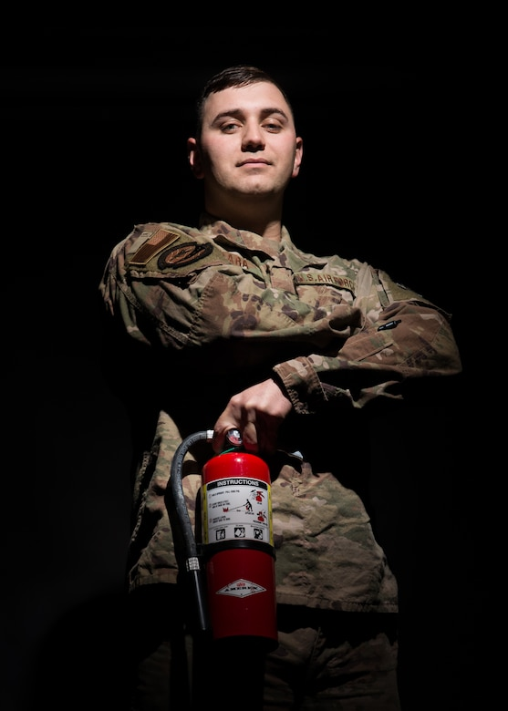 Tech. Sgt. Shiras Dara, 436th Logistics Readiness Squadron Distribution Maintenance Section chief, poses with a fire extinguisher, Nov. 18, 2019, at Dover AFB, Del. Dara used a similar fire extinguisher to put out a vehicle fire and credits his Air Force training for knowing how to properly use a fire extinguisher in a time of need. (U.S. Air Force photo by Mr. Mauricio Campino)