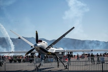 Aviation Nation attendees check out the MQ-9 Reaper static display during Aviation Nation, at Nellis Air Force Base, Nevada, Nov. 17, 2019. The 432nd Wing/432nd Air Expeditionary Wing has the only model MQ-9 Reaper in the Air Force inventory and has only traveled to air shows since summer 2017. (U.S. Air Force photo by Staff Sgt. Omari Bernard)