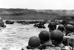 Troops watch activity on Omaha Beach as their LCVP landing craft approaches shore on D-Day, June 6, 1944 (U.S. Army Signal Corps/U.S. National Archives)