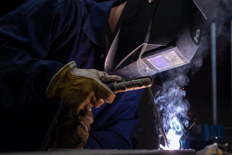 A photo of an engineering Airman welding a handrail