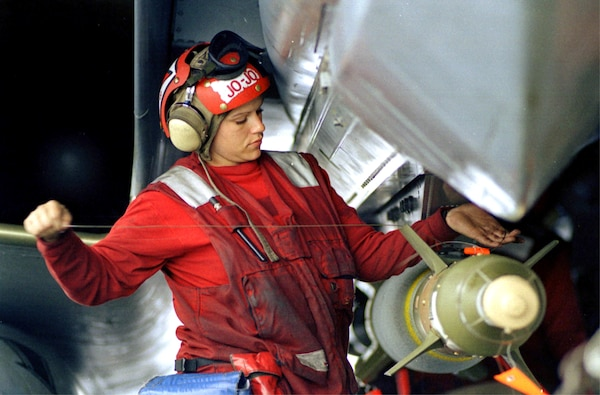 "Aviation ordnanceman applies final wiring to GBU-24 laser-guided bomb attached to F-14 ""Tomcat"" fighter aircraft on board USS Theodore Roosevelt during Allied Force, Adriatic Sea, May 4, 1999 (U.S. Navy/Dennis Taylor)"