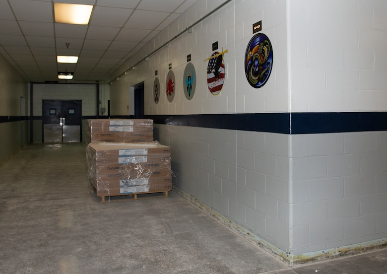 Equipment is stacked in a hallway of the Bennie Davis Maintenance Facility at Offutt Air Force Base, Neb. Nov. 18, 2019. Team Offutt is making headway toward restoration on many structures that were damaged during the historic flood earlier this year.