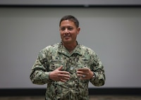 Capt. Khary W. Hembree-Bey, commanding officer of Naval Surface Warfare Center (NSWC) Corona, addresses employees during his monthly town hall meeting.