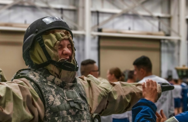 A 90th Mission Support Group Airman is evaluated on her ability to put on mission oriented protective posture gear during Warrior Day Nov. 21, 2019, on F.E. Warren Air Force Base, Wyo. There are five MOPP levels and every team was required to gear up to MOPP 4, the highest level, while being timed. The Warrior Readiness Program Team, is responsible for Warrior Day, decided to forgo the protective mask in MOPP 4 for sanitation purposes. (U.S. Air Force photo by Senior Airman Abbigayle Williams)