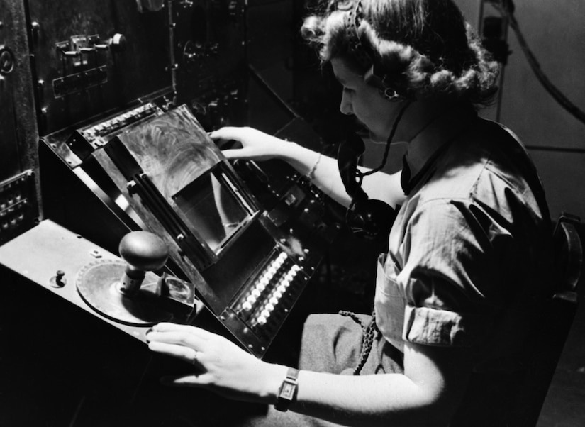 Women's Auxiliary Air Force radar operator Denise Miley plotting aircraft on cathode ray tube of RF7 receiver in Receiver Room at Bawdsey Chain Home radar station (Courtesy Royal Air Force, Imperial War Museum, Goodchild)
