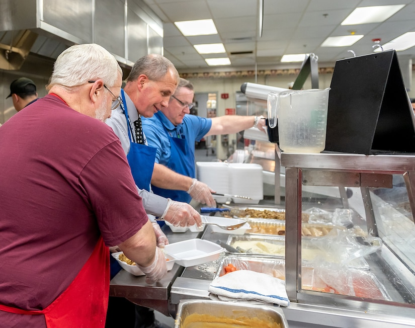Photo of employees being served dinner.