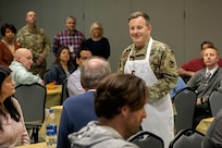 Brig. Gen. Mark S. Bennett, U.S. Army Financial Management Command commanding general, welcomes the USAFMCOM team to a Thanksgiving luncheon at the Maj. Gen. Emmett J. Bean Federal Center in Indianapolis Nov. 22, 2019. During the event, Bennett thanked those in the command for their hard work and said they build financial readiness one transaction at a time. (U.S. Army photo by Mark R. W. Orders-Woempner)