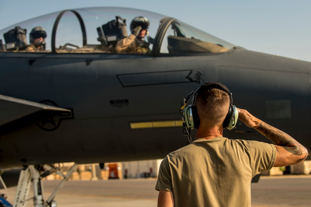 Airman marshals an F-15E Strike Eagle