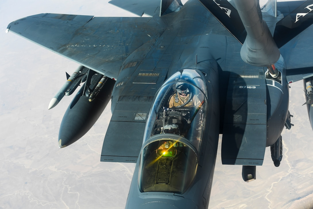 An F-15E Strike Eagle receives fuel from a KC-135 Stratotanker