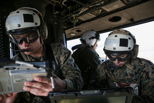 Marine Corps cryptologic analyst assigned to 1st Radio Battalion, I Marine Expeditionary Force Information Group, monitors electromagnetic spectrum during training in support of Command Post Exercise at Marine Corps Base Camp Pendleton, California, December 12, 2018 (U.S. Marine Corps/Brendan Mullin)