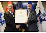 DCMA Deputy Director presents Michael Beaupre with his SES certificate.