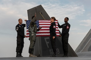 Reenlistment ceremony for an F-22 Demonstration Team aircrew flight equipment technician