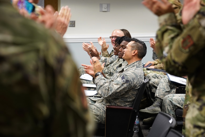 Chaplain Corps leadership applaud religious affairs course students during their graduation inside Wolfe Hall at Keesler Air Force Base, Mississippi, Nov. 22, 2019. The six-week course was relocated and revamped to improve the quality of training for students. (U.S. Air Force photo by Airman Seth Haddix)