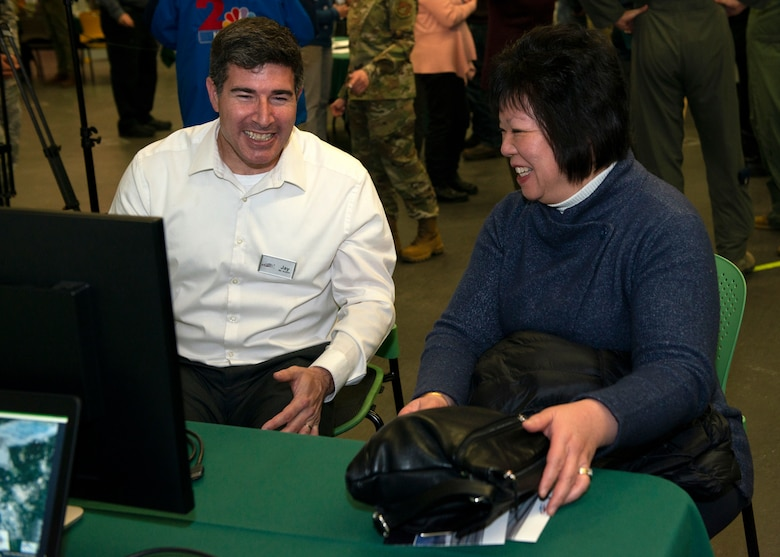 Jay Austin, an environmental analyst with Leidos, talks about noise contours with Carol Wong, an Anchorage resident, during an Air Installation Compatible Use Zone study open house in Anchorage, Alaska, Nov. 20, 2019. Joint Base Elmendorf-Richardson, Alaska, hosted the event, which showed the results of the study, to promote transparency between the installation and its community partners.