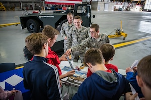 Senior Airman Landon Wineland, 932nd Airlift Wing Maintenance Squadron technician, speaks with students about maintenance careers and some of the equipment used to repair aircrafts during the STEAM Day event  held Nov. 20, 2019, at Scott Air Force Base, Illinois. The day inspires kids to explore and pursue their interests in Science, Technology, Engineering, Art and Math.