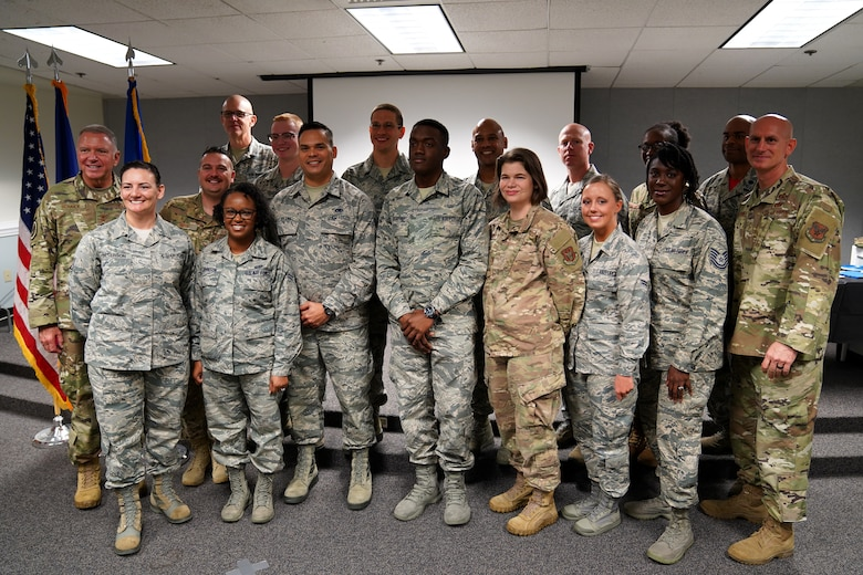 Religious affairs course students pose for a picture during their graduation inside Wolfe Hall at Keesler Air Force Base, Mississippi, Nov. 22, 2019. The six-week course was relocated and revamped to improve the quality of training for students. (U.S. Air Force photo by Airman Seth Haddix)