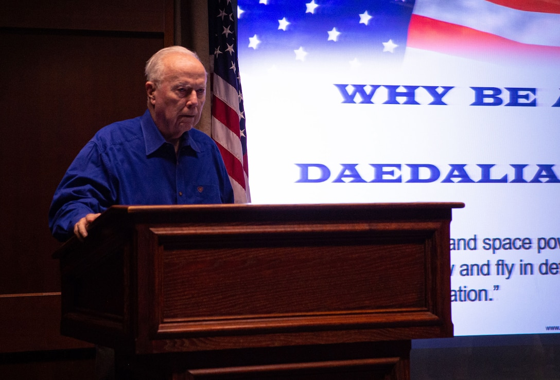 Retired U.S. Army Col. Bruce Crandall, a Medal of Honor recipient, talks about his time in the service during a professional development presentation at Joint Base Lewis-Mcchord, Wash., Nov. 21, 2019. Crandall received the Medal of Honor for his actions as a pilot during the Battle of Ia Drang, Vietnam, in 1965. (U.S. Air Force photo by Senior Airman Tryphena Mayhugh)
