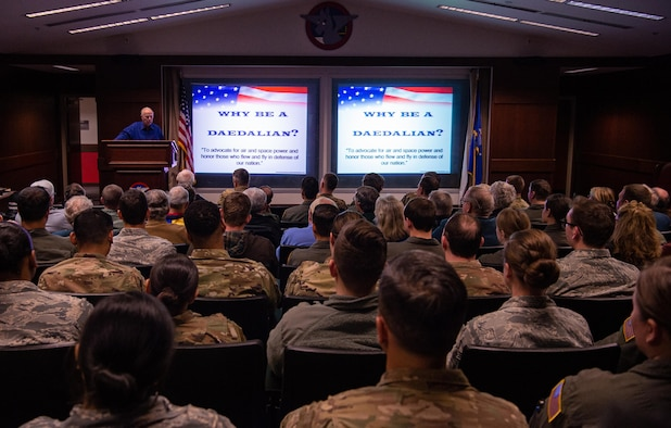 Retired U.S. Army Col. Bruce Crandall, a Medal of Honor recipient, talks about his time in the service during a professional development presentation at Joint Base Lewis-Mcchord, Wash., Nov. 21, 2019. By the end of the Vietnam War, Crandall had flown more than 900 combat missions. (U.S. Air Force photo by Senior Airman Tryphena Mayhugh)