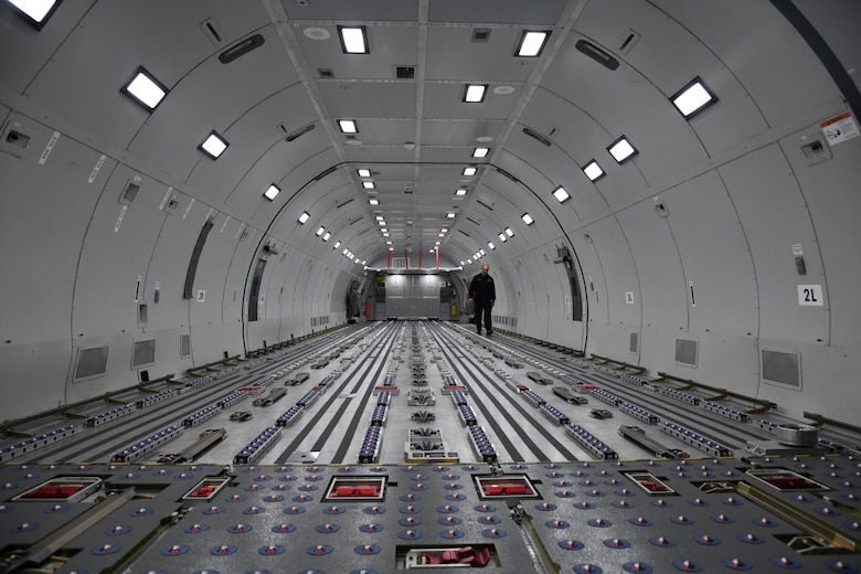Bradford Voorhees, 22nd Civil Engineering Squadron A shift captain, walks along the interior of a KC-46 fuselage trainer Nov. 12, 2019 at McConnell Air Force Base, Kan. The fuselage is typically used by boom operators for quarterly cargo load training, allowed participants in the training to get hands on experience operating the interior of a KC-46. (U.S. Air Force photo by Airman 1st Class Nilsa E. Garcia)
