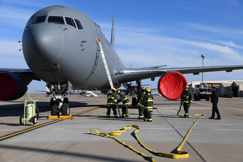 McConnell firefighters demonstrate how to properly gain access into a KC-46 Pegasus during the KC-46 Firefighter Symposium Nov. 13, 2019 at McConnell Air Force Base, Kan. A total of 12 firefighters across all Air force Fire and Emergency Services organizations had the opportunity to participate in the three-day training. (U.S. Air Force photo by Airman 1st Class Nilsa E. Garcia)